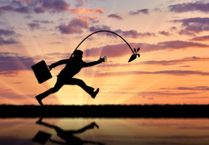LeadQuine What Motivates You Blog Business man chasing carrot in sunset