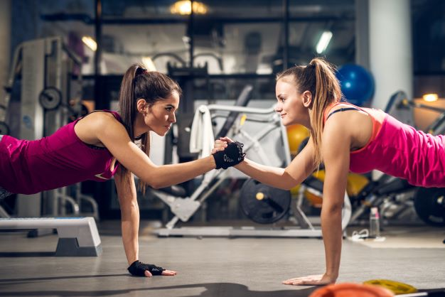 LeadQuine What Motivates Them? Two women working out. Blog