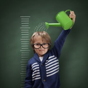 LeadQuine Do It Myself Blog Kid watering self with growth chart